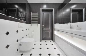 Дизайн ванной комнаты с черной плиткой на полу